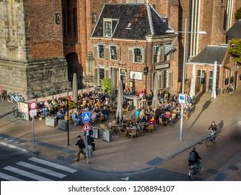 Groningen, Holland - 19 october 2018: People enjoying the evening sun on a terrace. in Groningen.