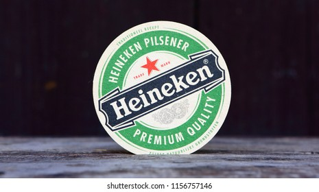 GRONINGEN, HOLLAND - April 2, 2017.: Beer mats from Heineken Lager Beer in vintage background , it was first brewed by Gerard Adriaan Heineken in 1873