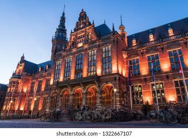 GRONINGEN - HOLLAND, February 23, 2019: Academy building of the University of Groningen illuminated at night.