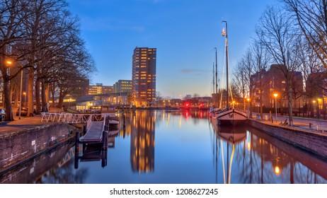 GRONINGEN, NETHERLANDS, 27 DECEMBER, 2016: Old harbor Westerhaven scene in historic part of Groningen city at twilight around christmas time