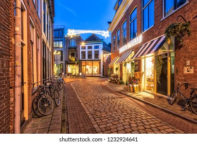 GRONINGEN, NETHERLANDS, 27 DECEMBER, 2016: Street scene in historic part of Groningen city at twilight around christmas time