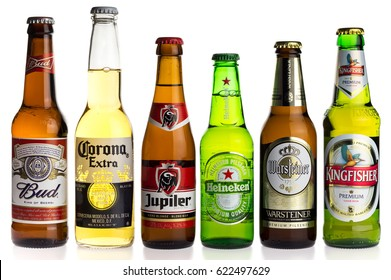 GRONINGEN, NETHERLANDS - APRIL 15, 2017: Collection of Budweiser, Corona, Jupiler, Heineken, Warsteiner and Kingfisher lager beers isolated on a white background