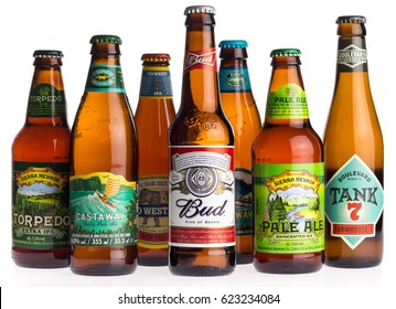 GRONINGEN, NETHERLANDS - APRIL 16, 2017: Collection of American Sierra Nevada, Anchor, Budweiser, Kona and Boulevard beers isolated on a white background