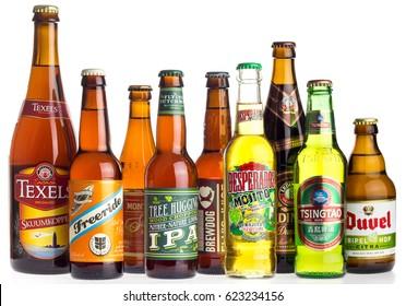 GRONINGEN, NETHERLANDS - APRIL 16, 2017: Collection of Texels, Freeride, Monteiths, Flying Dutchman, Brewdog, Desperados, Erdinger, Tsingtao and Duvel beers isolated on a white background