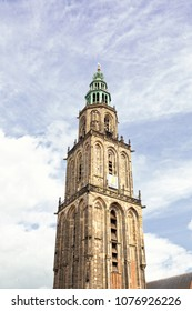 GRONINGEN, THE NETHERLANDS, APRIL 2018. Landmark Martini Tower / Martinitoren and church in the city center of Groningen. Shot against a dramatic sky.