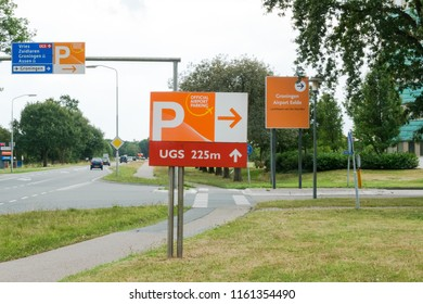 GRONINGEN, NETHERLANDS, AUGUST 15, 2018: Signage of parking on the airport of Groningen (Eelde), Netherlands with roadsigns on the background