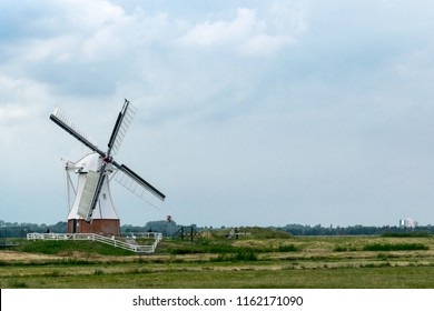 GRONINGEN, NETHERLANDS, AUGUST 15, 2018: The white mill (De Witte Molen) near the village Haren, Groningen, in the countryside of the providence of Groningen, Netherlands