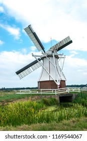 GRONINGEN, NETHERLANDS, AUGUST 15, 2018: The White Mill (Witte Molen) at Groningen, a typical Dutch historic mill in the north of The Netherlands