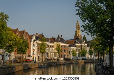groningen, NETHERLANDS - August 28, 2018: Water and street in Groningen center. Church in the back