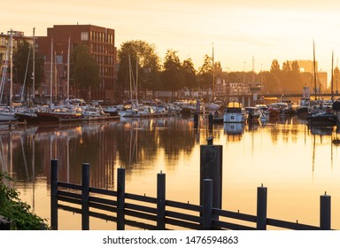 GRONINGEN - THE NETHERLANDS, August 9, 2019: A summer sunrise at a canal in the city center of Groningen, Holland.