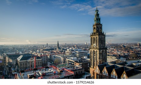 GRONINGEN, NETHERLANDS - DECEMBER 1, 2019: On the roof of the Forum building. Viewing the rooftop and the Martinitoren in the back. Skyline of Groningen, viewed from the Forum