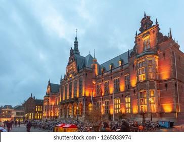 Groningen, Netherlands. December 19, 2018. The Academy Building of the University of Groningen, illuminated during the Golden Hour.