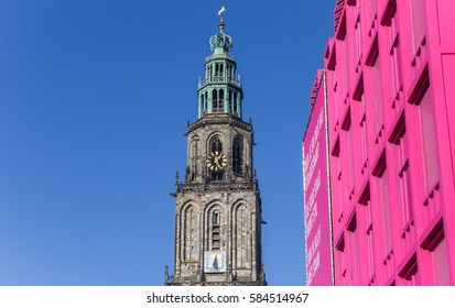 GRONINGEN, NETHERLANDS - FEBRUARY 15, 2017: Martini tower and pink building in the center of Groningen, Holland