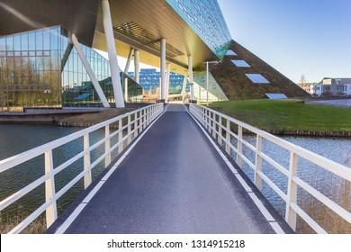 GRONINGEN, NETHERLANDS - FEBRUARY 15, 2019: Bridge leading to the Linnaeusborg building in Groningen, Netherlands