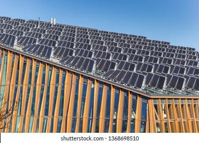 GRONINGEN, NETHERLANDS - FEBRUARY 15, 2019: Solar panels on the roof of the Energy Academy Europe building in Groningen, Netherlands