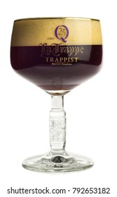 GRONINGEN, NETHERLANDS - JANUARY 12, 2018: Glass of La Trappe Dubbel beer isolated on a white background