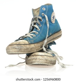 Groningen, Netherlands - January 16, 2018: Blue Chuck Taylor Converse All Star low tops against a white background. - Image. Old and worn  converse shoe