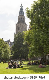 GRONINGEN, NETHERLANDS - JULY 19, 2013: Meeting place for young people in a park in the city center with the Martini tower in the back