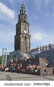 GRONINGEN, NETHERLANDS - JULY 19, 2013: people meeting below the Martini tower in the city center