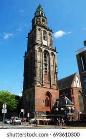 GRONINGEN, THE NETHERLANDS, July 22, 2017: The Martinitoren (St Martin's Tower) is the highest church steeple in the city of Groningen