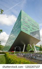 GRONINGEN, NETHERLANDS - JUNE 6, 2017: Linnaeusborg life sciences faculty building on Zernike complex of Groningen University. With bikes in front