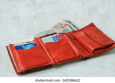 GRONINGEN, THE NETHERLANDS- NOV 5, 2007: Red leather purse filled with euro bills and credit cards