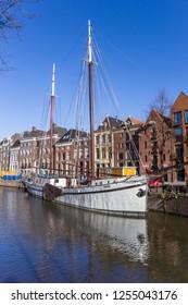 GRONINGEN, NETHERLANDS - NOVEMBER 08, 2018: Historic sailing ship in the Hoge der aa canal of Groningen, Netherlands