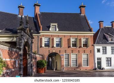 GRONINGEN, NETHERLANDS - NOVEMBER 08, 2018: City gate Gardepoort at the Martinihof square in Groningen, Netherlands