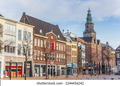 GRONINGEN, NETHERLANDS - NOVEMBER 18, 2018: Fish market square and Martini church tower in Groningen, Netherlands
