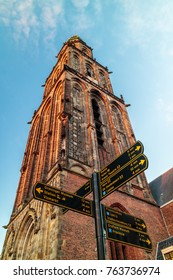 GRONINGEN, THE NETHERLANDS - NOVEMBER 2, 2017: The famous Martinitoren church tower in Groningen with tourist guidance signs in front