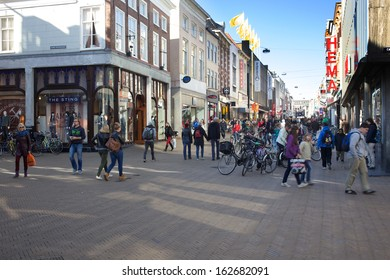 Groningen, The Netherlands - october 1 2013: People shopping in the high street of the city of Groningen: Herestraat