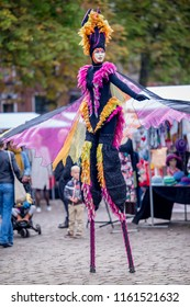 Groningen, The Netherlands - October 1, 2016: Performer that is colourfully dressed performing on stilts at the Groningen market