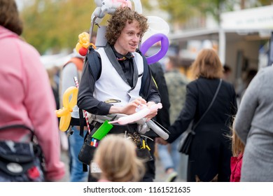 Groningen, The Netherlands - October 1, 2016: Balloon artist walking around on the Saturday morning market of Groningen in The Netherlands offering to make figures and animals out of balloons