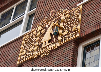 Groningen, Groningen Province, The Netherlands - 07/11/2018:  A gold emblem on a brick exterior wall, depicting the Coendershuis building (building with an old elevator).