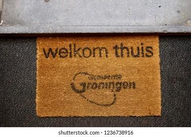 """Groningen, Groningen Province, The Netherlands: 07/11/2018: """"welkom thuis"""" Groningen door mat (""""welcome home"""" door mat in Dutch). Groningen City logo printed on the coco coir."""