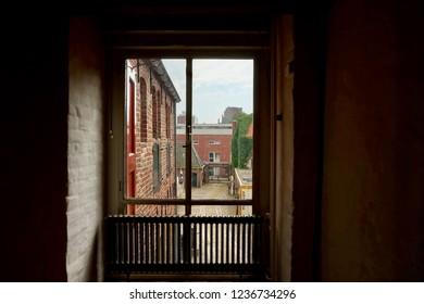 Groningen, Groningen Province / The Netherlands - 07/28/2018: Window lookout of a restored medieval building in Europe.