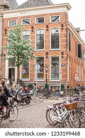 The Groningen university and bicycles parking in front of it. The Netherlands, Groningen. 10 May 2018