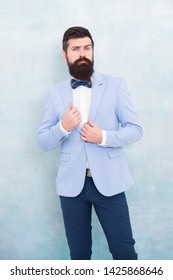 Groom bearded hipster man wear light blue tuxedo and bow tie. Wedding day. Stylish groom. Statement with his stunning crisp suit jacket. Stylist fashion expert. Suit style. Fashion trends for groom.