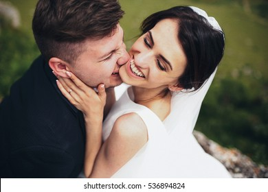The groom bites his bride
