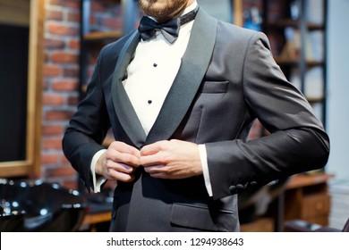 Groom in black tuxedo and bowtie