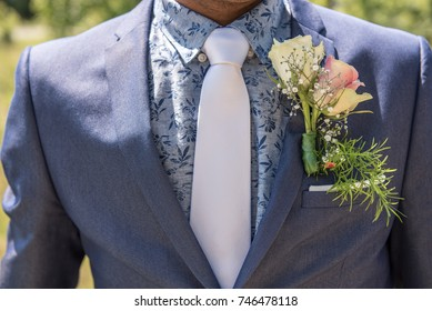 Groom with blue suit with with tie