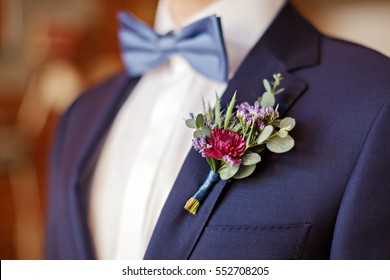 The groom in a bow tie and a buttonhole