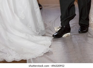 Groom breaking a glass at a Jewish wedding stamping it underfoot symbolizing the destruction of the temple in Jerusalem, close up of the right foot