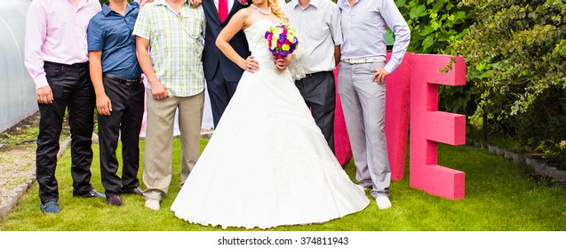 Groom and Bride With Best Man And Groomsmen At Wedding