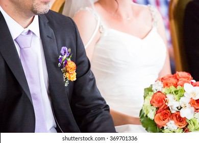 Groom and bride with a bouquet on a wedding ceremony.