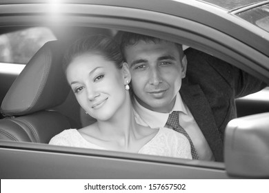 groom and bride, in car