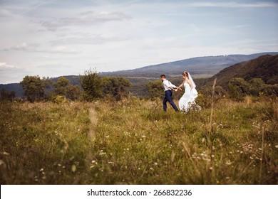 Groom and bride enjoy their wedding day