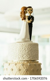 Groom and Bride figurines on a wedding cake