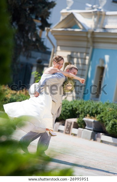 Groom and bride jumping