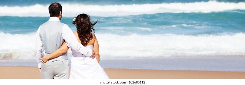 groom and bride on beach